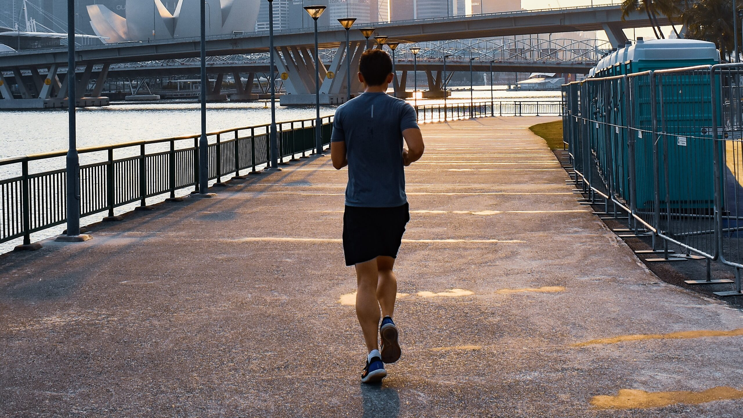 The back of a man jogging in a city