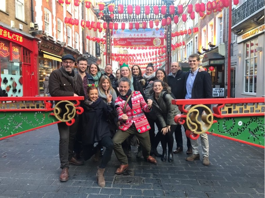 group of people posing for a picture in Chinatown