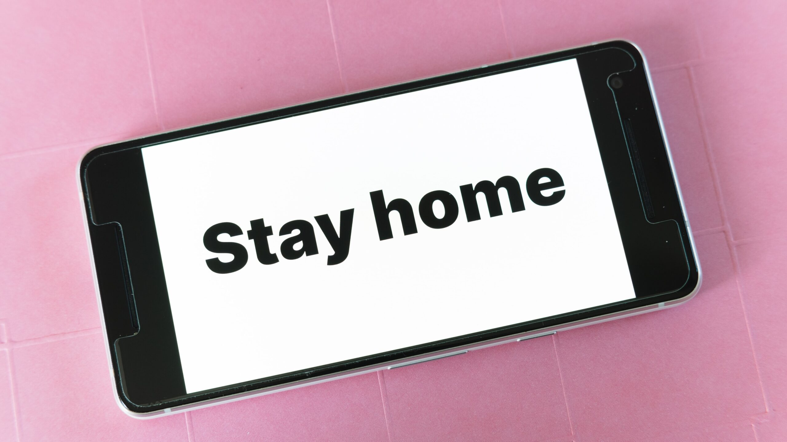 Phone with 'stay home' on screen