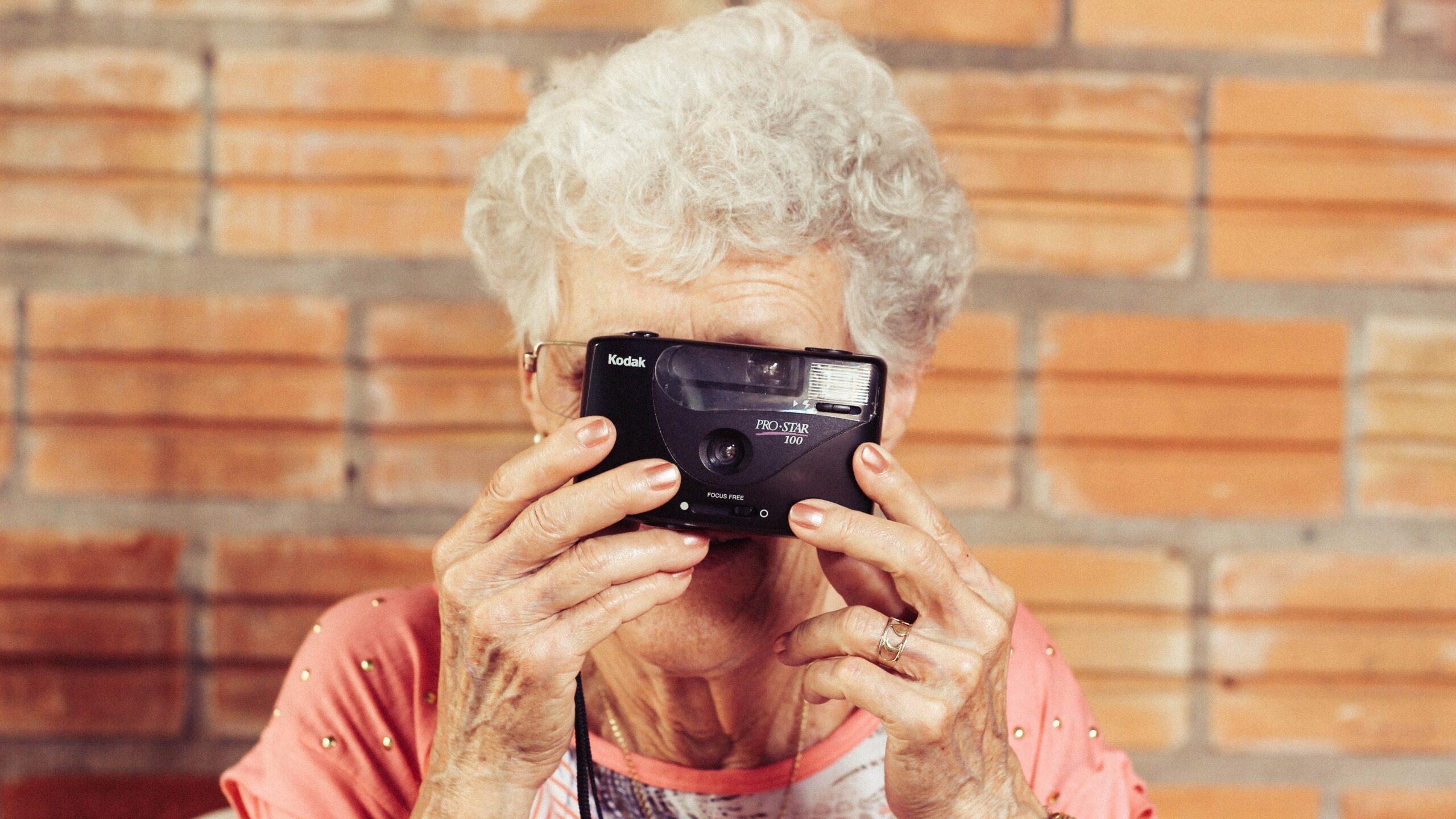 Elderly woman taking a photo